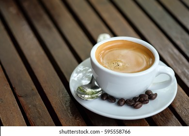 Breakfast coffee, Espresso coffee and roasted coffee beans on wooden table background