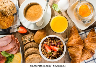 breakfast of coffee, juice, muesli, breads, ham and cheese - top view