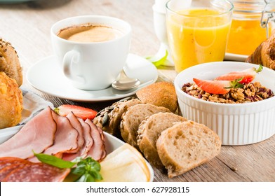 breakfast of coffee, juice, muesli, breads, ham and cheese