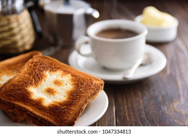 Breakfast with coffee and toasts. Toast with bitcoin symbol.