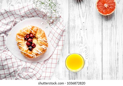 Breakfast concept with flowers on wooden background top view