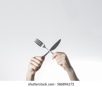 breakfast concept, hands hold knife and fork crosed,  Space for text, free space,