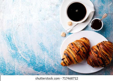 Breakfast Continental  with Fresh  Croissant in Metal Basket .Delicious Baking   Street Food. Top View Copy space for Text