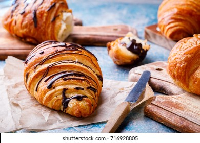 Breakfast Continental  with many Fresh  Croissants with Chocolate and sauce on a blue Background  Delicious Baking Top View Copy space for Text
