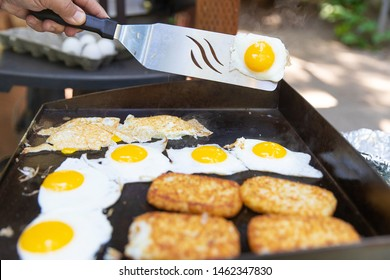 Breakfast cooked on a flat, outdoor grill