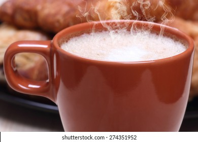 Breakfast croissant and hot cappuccino