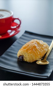Breakfast croissant on black table​ and coffee background