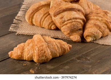 Breakfast croissant on a rustic background