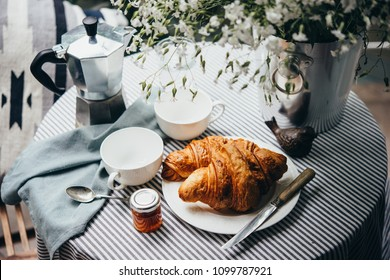 Breakfast with croissants, jam and coffee
