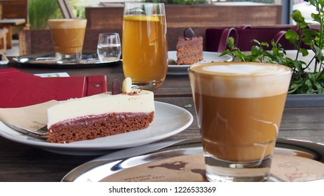 breakfast cup of coffee with mascarpone cheesecake with chocolate cake cake on a wooden table