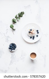 Breakfast with cup of coffee, sweet dessert, blueberry. Flat lay, top view