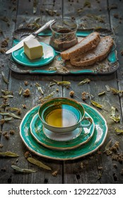 Breakfast with a cup of linden tea, butter and homemade bread