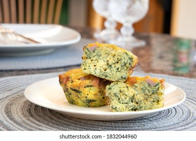 Breakfast Egg Muffins loaded with fluffy eggs, potatoe, spinach, melted cheese and crisp bites of Canadian bacon.