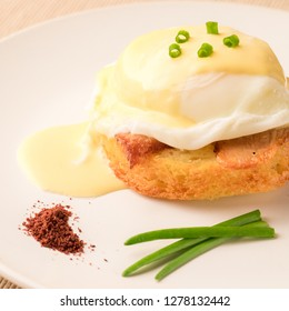 Breakfast is Eggs Benedict - toasted English muffins, bacon, ham, poached eggs, herbs and delicious buttery hollandaise sauce.
