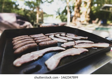 Breakfast food cooking on a camp grill