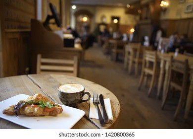 breakfast in a French cafe / croissant with salmon and salad for breakfast in a restaurant