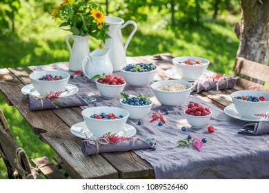 Breakfast with fresh berries and granola in summer