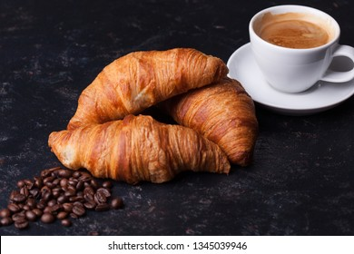 Breakfast with freshly baked croissants and cup of coffee. Golden crust.
