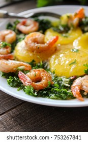 Breakfast of fried egg yolks, shrimp with dressing of greens
