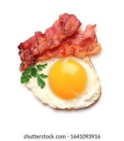 Breakfast with fried eggs and bacon isolated on white backgrounds . Fried eggs isolated on white backgrounds.