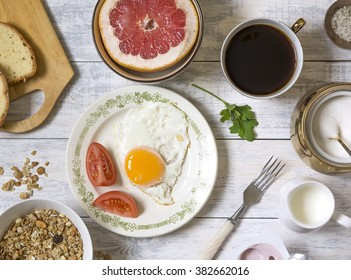 Breakfast fried eggs muesli and tomatoes. Breakfast top view