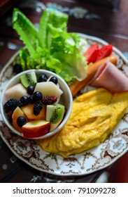 Breakfast with fruit and omelet