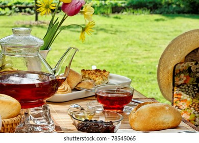 Breakfast in the garden with sweet food and tea.