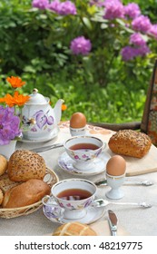 Breakfast in the garden with tea and a simple food.