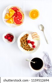 Breakfast with granola with yogurt and berries. Still life of fresh fruits and berries and bowl of breakfast granola with pistachio, apple, raspberries, top view. Healthy breakfast concept.