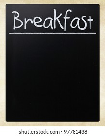 """Breakfast"" handwritten with white chalk on a blackboard"