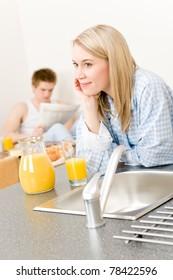 Breakfast happy couple drink orange juice in morning kitchen