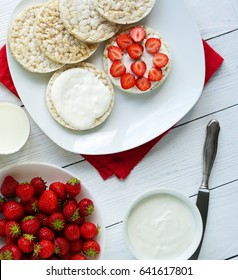 Breakfast for health sandwiches from rice vegan waffle with Greek yogurt and fresh strawberries on a white red background.top view. flat lay