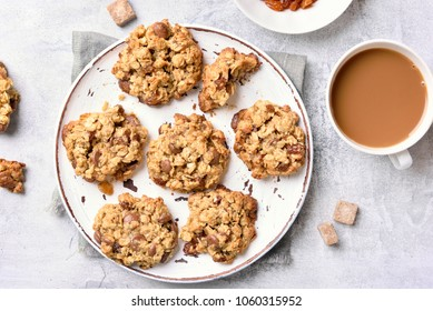 Breakfast with healthy oatmeal cookies on stone background. Top view, flat lay
