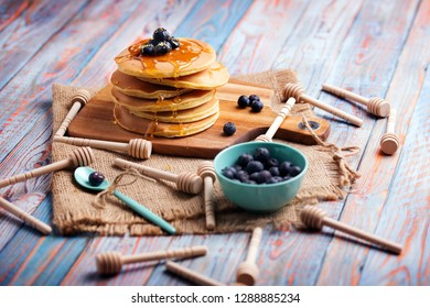 breakfast with honey and berry pancakes