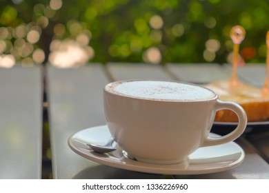 Breakfast hot cappuccino coffee and nature background