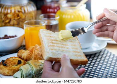 Breakfast in hotel restaurant home made breads served for continental breakfast freshly with croissants, orange juice and coffee or tea, egg, milk, bread, butter or jam, fruits, fresh vegetables.
