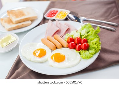 Breakfast includes eggs , sausage, ham ,bread.