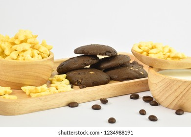 Breakfast includes milk, chocolate cookies And Honey Star Cereal Coffee on a white background.