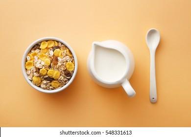 Breakfast ingredients. Cereals with milk. Top view