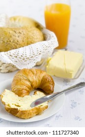 Breakfast items displayed on a white tablecloth
