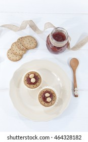breakfast jam with crackers, biscuits, cookies and cheese, white background wood