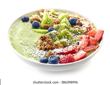 breakfast kiwi smoothie bowl topped with oat flakes and berries isolated on white background