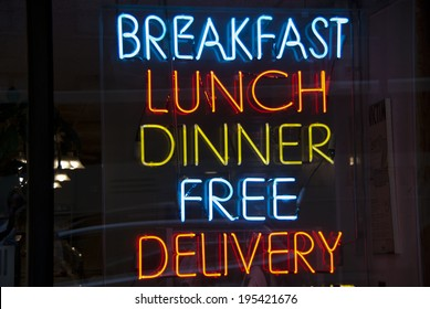 Breakfast, Lunch, Dinner neon sign in a New York City diner