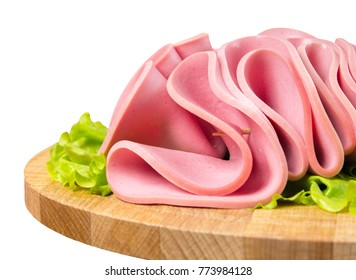 Breakfast luncheon Turkish sausage. Slices of beef meat in the form of mortadella on salad. Isolated on white background - Shutterstock ID 773984128