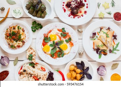 Breakfast meals variety in restaurant flat lay. Top view on buffet table with different tasty snacks. Menu, banquet, party, appetizer concept