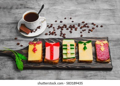 Breakfast for men. Figured snack sandwiches, coffee, chocolate. Sausage sandwiches, cheese, vegetables. Concept sandwiches Breakfast for day men, father's day, business lunch, 23 February.