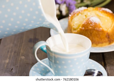 Breakfast with milk and a homemade sponge cake