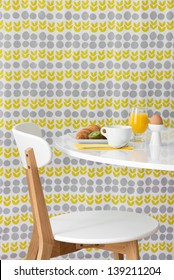 Breakfast. Modern table and chair on bright floral background.