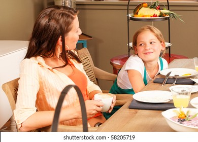 breakfast mother and daughter looking and talking to each other