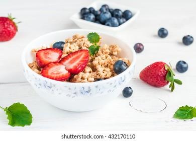 Breakfast with muesli and berries